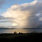 Mystical Sweeping rain shower over lough Foyle, Derry, Ireland. by mikequigley