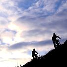 Mountain bikers on skyline by turniptowers