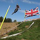 Mountain biker jumping with union jack by turniptowers
