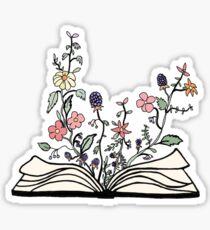 Pegatina flores que crecen del libro