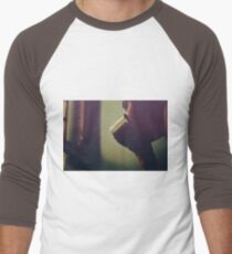 alice looking through the windows T-Shirt