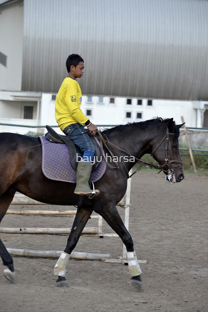 young boy riding horse by bayu harsa