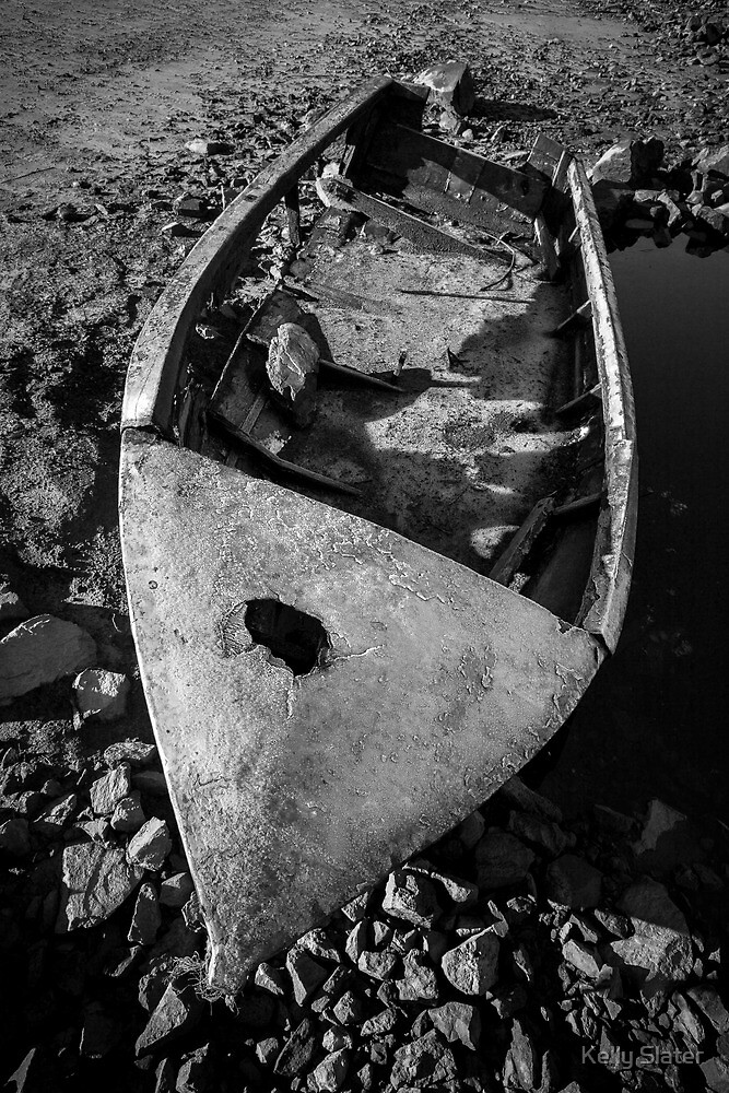 Washed up dinghy by Kelly Slater