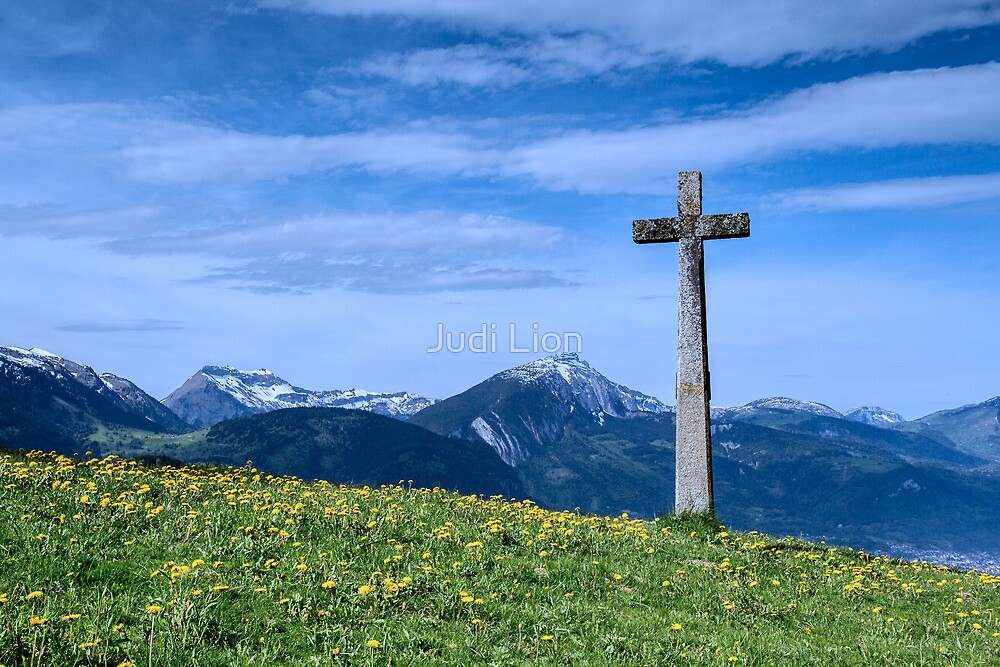 A stone cross in an Alpine Meadow by Judi Lion