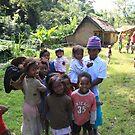 Madagascan Family-   road side Antanarivo Madagascar by john  Lenagan