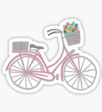 pink bike with flower baskets Sticker