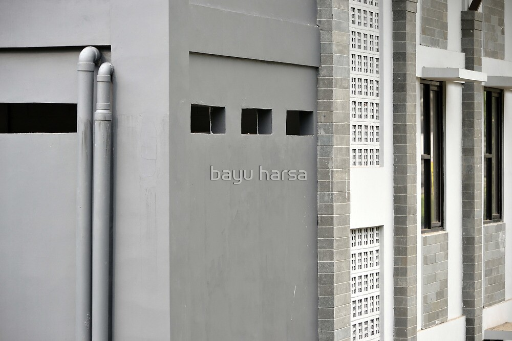 grey concrete wall by bayu harsa