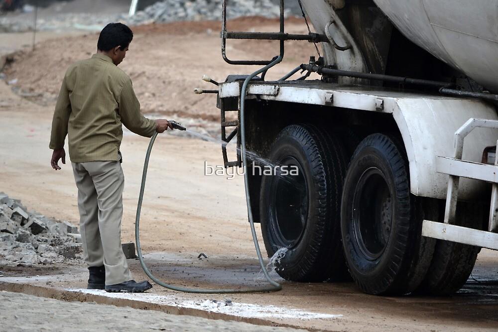 man washing concrete mixer truck by bayu harsa