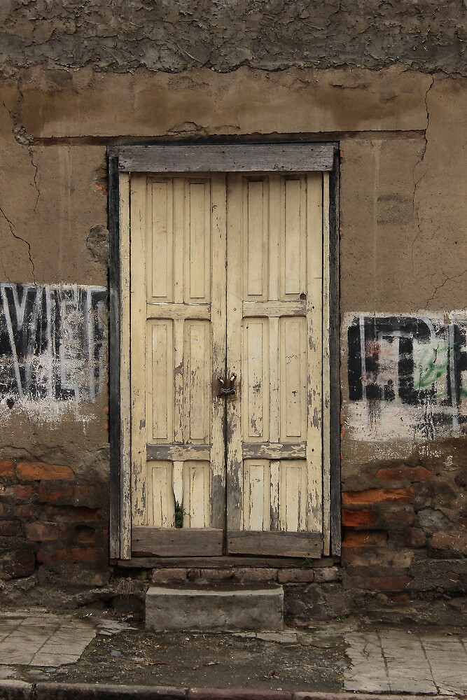 Weathered Yellow Door in a Wall by rhamm