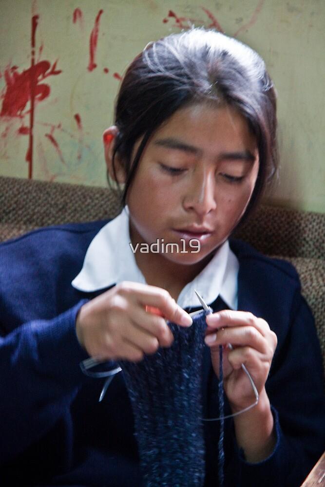 Ecuador. Portrait of a boy knitting. by vadim19