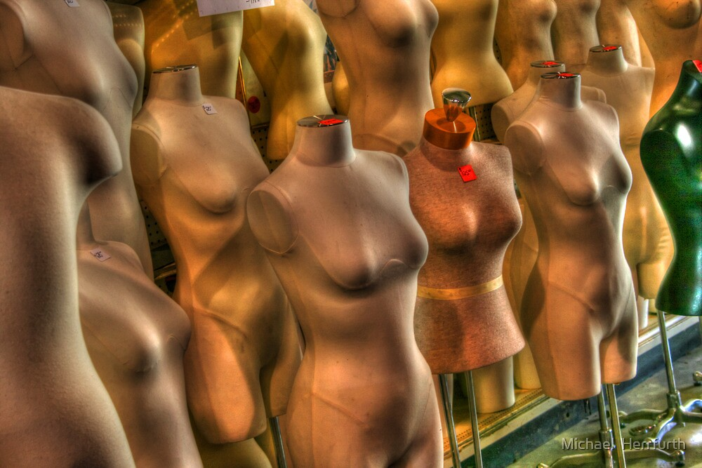 Mannequins in a Row by Michael  Herrfurth