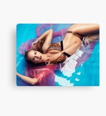 Beautiful woman in bikini lying in blue with red water art photo print Canvas Print