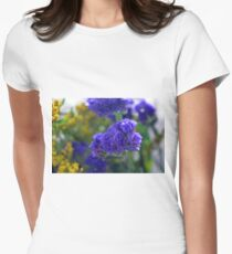 Purple flowers, nature background. T-Shirt