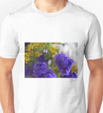 Purple flowers, nature background. T-Shirt