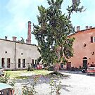 Brisighella: courtyard and building with pink facade by Giuseppe Cocco