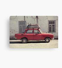 A car with a bathtube Canvas Print