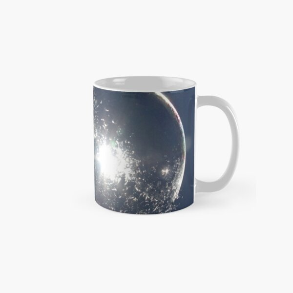 Bubble bursting on fingertip Classic Mug
