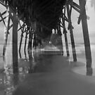 Under the Pier and Beach in Black and White by KellyHeaton