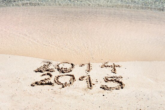 Happy New Year 2015 replace 2014 concept on the sea beach by Stanciuc