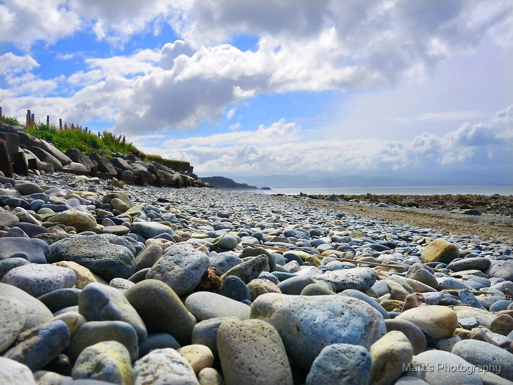 Pebble filled Beach in Wales Great Britain by Matt's Photography