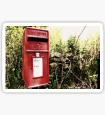 Vintage red postbox in the countryside Sticker