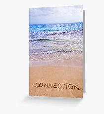 Connection word written on sand, with waves in background Greeting Card