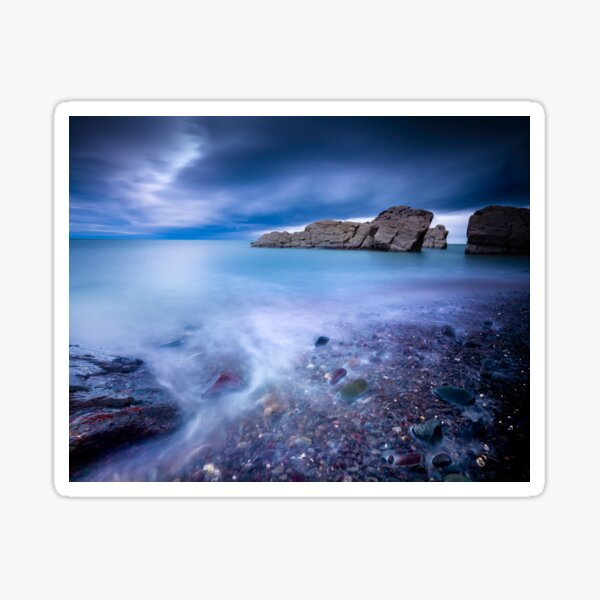 Long exposure seashore with moody sky and rocks Sticker