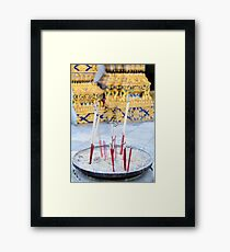 Bowl with joss sticks Framed Print
