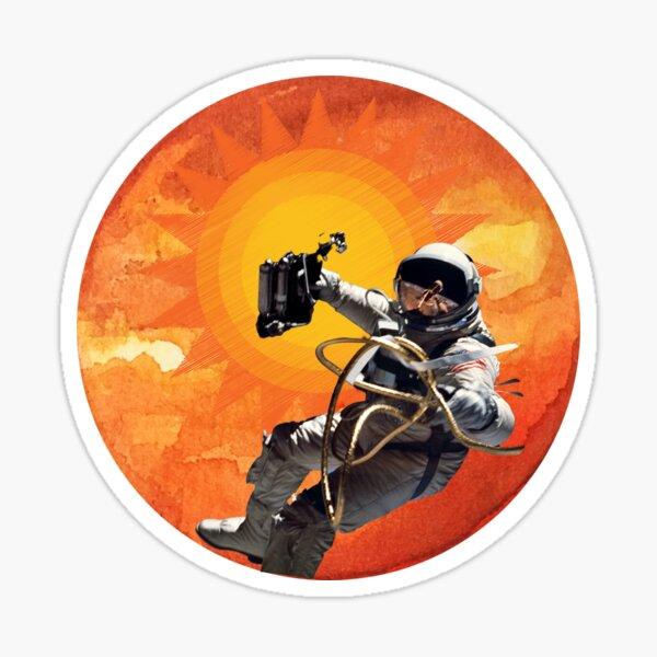 Space Walking Astronaut against the orange sun Sticker