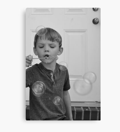 Little boy blowing bubbles black and white photo 1 Canvas Print