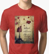 hearts are wild creatures Tri-blend T-Shirt