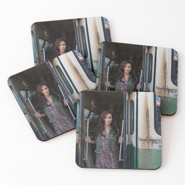 Woman standing in the doorway of a derelict bus Coasters (Set of 4)
