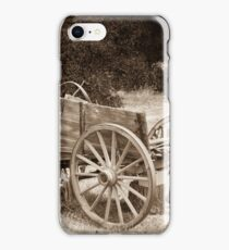 Old Wild West wagon abandoned in a meadow iPhone Case/Skin