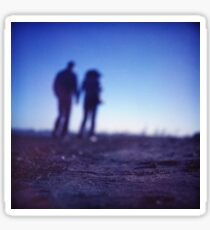 Romantic couple walking holding hands on beach in blue Medium format color negative film photo Sticker