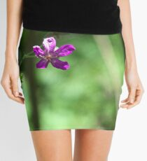 A Little Fushia Among the Green Mini Skirt