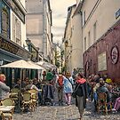 On the streets of Montmartre by John Rivera