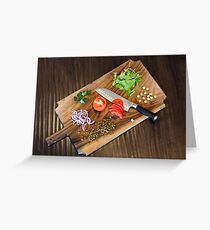 Freshly cut vegetables on a cutting board with a chef's knife  Greeting Card