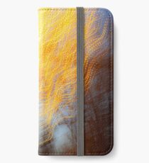 Abstract defocused colour lights in a dark blue night sky iPhone Wallet