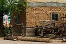 Mesilla Adobe and Wagon  by Larry Costales