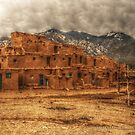 Taos Pueblo with clouds by Quixotegraphics