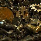Nuts, bolts, and a penny by Joe Saladino