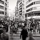 One in a crowd - Japan by Norman Repacholi