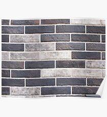 Decorative brickwork closeup of gray and black bricks Poster