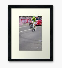 Cyclist on the road Framed Print