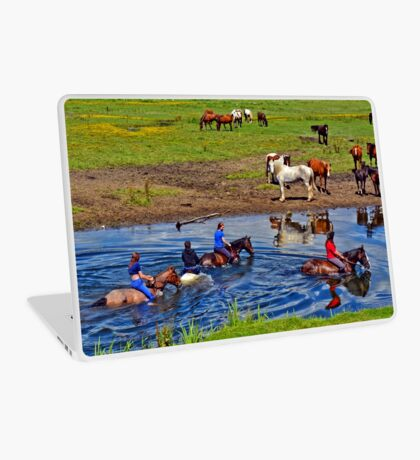 Horse riding in a river, near Ogmore Castle, Wales Laptop Skin