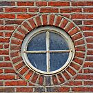 Red Brick Wall with Round Window, 17th century house, England by Remo Kurka