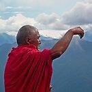 monk taking selfie by Istvan Hernadi