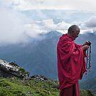 monk sending sms to god by Istvan Hernadi