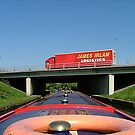 The fast lane and slow lane,  Motorway and Canal. UK. by Roy  Massicks