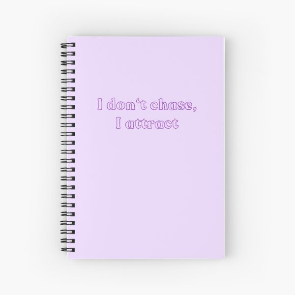 I don't chase, I attract purple Spiral Notebook